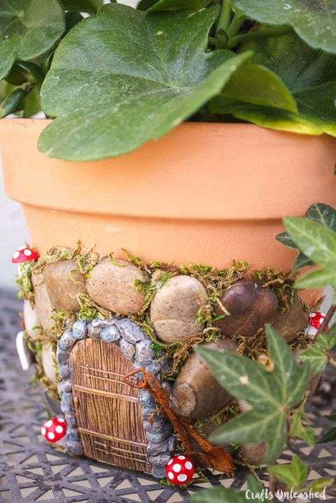 For a quick garden that doesn't take up much room, add a whimsical fairy door to a terra cotta pot on your back porch. Click through for a how-to and other DIY fairy garden ideas.