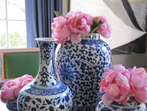 blue and white vases with pink peonies
