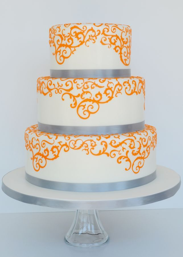 Wedding cake for a orange and grey themed wedding.  The scrollwork is done with a cake cricut.  TFL!