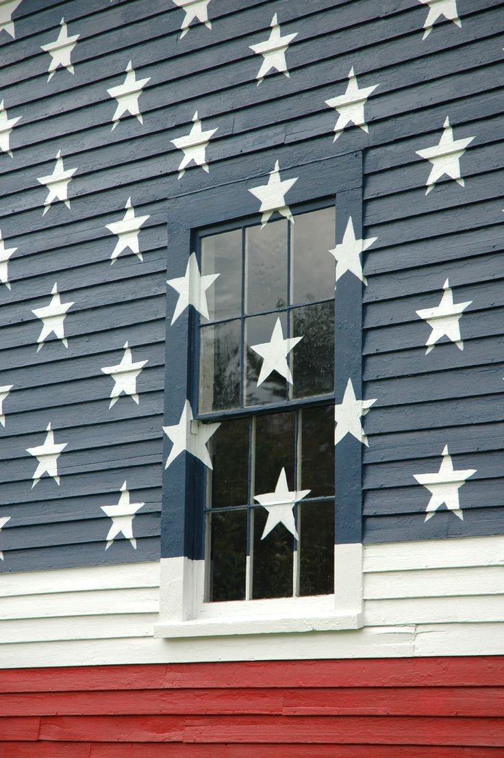 American flag painted on barn....stars right over the windows!