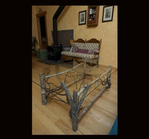 """Rustic Coffee Table. This """"unpeeled"""" table of salvaged woods stands 18"""" tall and includes forked applewood and curly willow."""