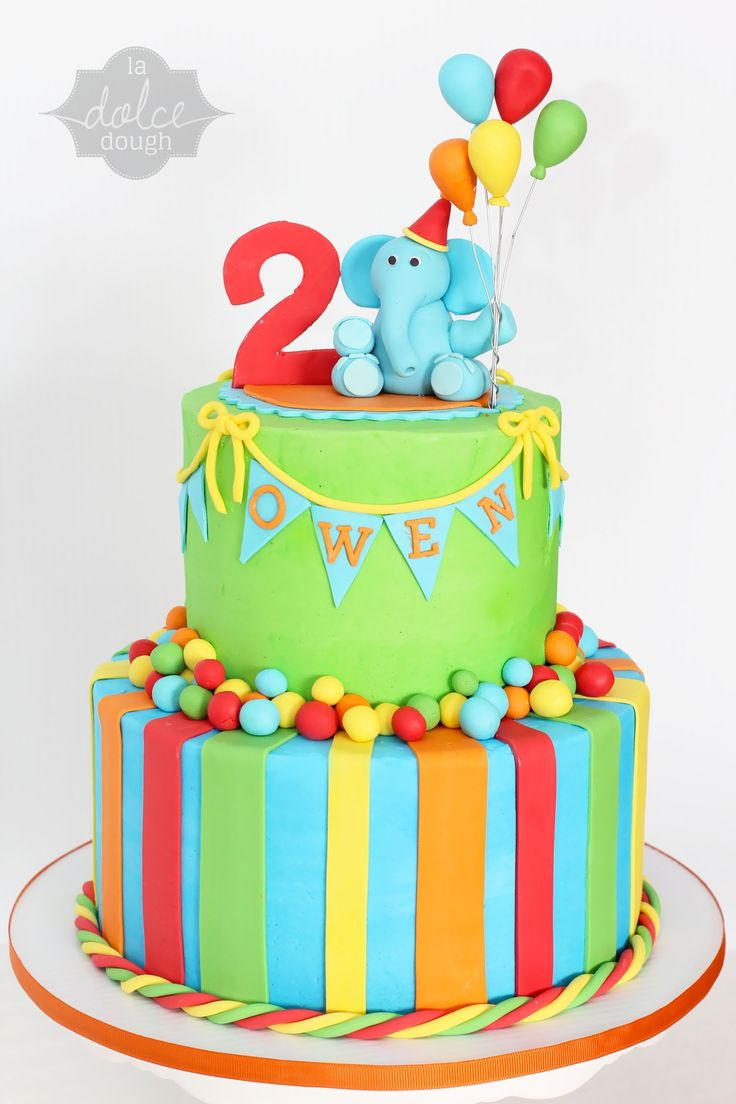Elephant Bright Birthday Cake - Buttercream 2 tiered cake with fondant accents. Fondant Elephant on top holding 5 balloons