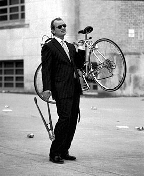 Bill Murray steals a bike.  Tags: Bill Murray Rushmore still photographer: Van Redin bicycle bicycle thief