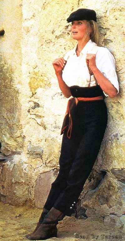 Bo Derek rocking the menswear look. I now see how I need to wear pants to make suspenders work with a bust my size. Winner!