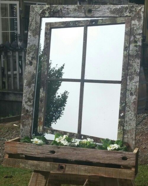 Rustic frame open window with garden box