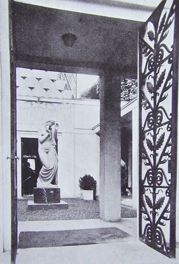 Paris Exposition 1925. Polish Pavilion; architect, Joseph Czajkowski: Adjoining the ante-room there was a pleasant atrium in the centre of which was a marble figure. The detail of the carving was somewhat barbaric and the furnishings heavy and inelegant.