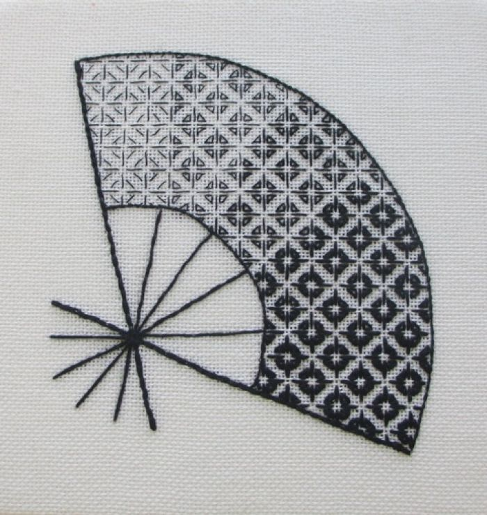 excellent example of gradients and shading using blackwork embroidery