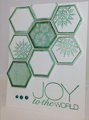 handcrafted Christmas card from Simon Says Stamp Blog! ,,, large hexagon pattern combining die cut hexagons with borders ... some with no color, some with off the edge stamped snowflake ...  two color card: white and green (looks like the year's favorite color of green from Pantone) ... like this card!!