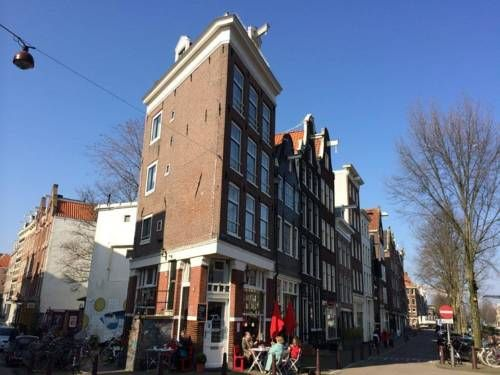 Bridge Inn Amsterdam Bridge Inn is set in the Amsterdam City Centre district in Amsterdam, 700 metres from Anne Frank House.  Each room is equipped with a flat-screen TV. Enjoy a cup of tea while looking out at the river or city.