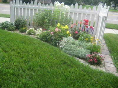 Corner of the driveway home ideas pinterest flower for Corner flower bed ideas