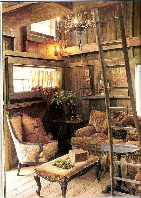 Victoria magazine. The fabrics here add a softer more comfortable appeal to an otherwise rustic interior.