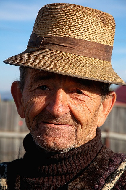 Old man at the weekly livestock market, Maramures by iancowe, via Flickr