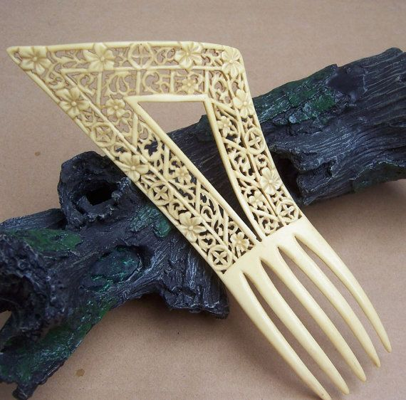 Hey, I found this really awesome Etsy listing at https://www.etsy.com/listing/208825819/art-deco-hair-comb-french-ivory
