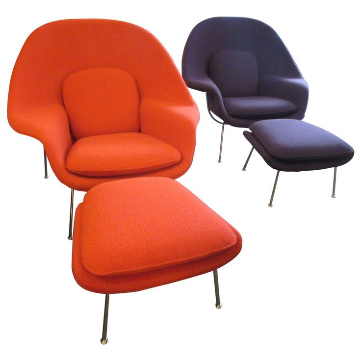 Two womb chairs with ottomans both covered in Knoll bouclé fabric, black iris and crimson. Chromes frame and legs.