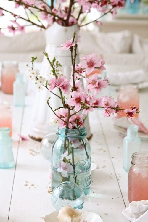 pink blossoms in a turquoise / blue jar