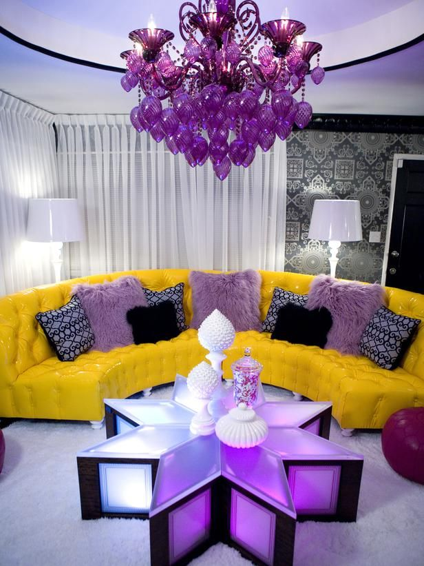 The cushions on this sofa really make the room.  Note how the use of complementary colors purple and yellow play off of one another so well.  When we make your custom cushions, consider using the color that is the complement to your sofa.