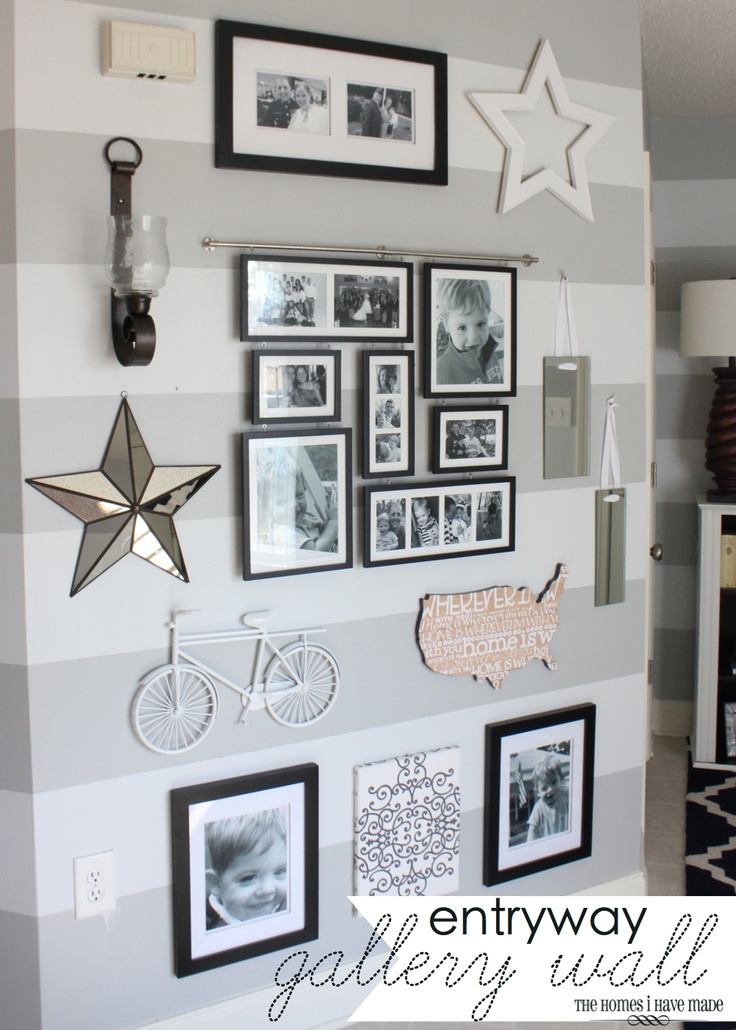 Gallery wall - like the combo of family pictures and quirky wall hangings, and that it goes from floor to ceiling.