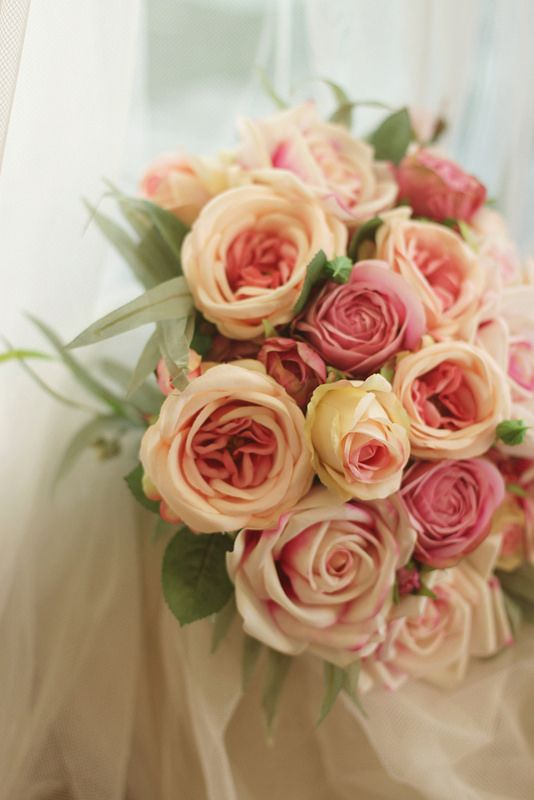 Abbi's bouquet - lots of different pink roses.   Real touch open roses, David Austin style roses, garden tea roses and spray roses.