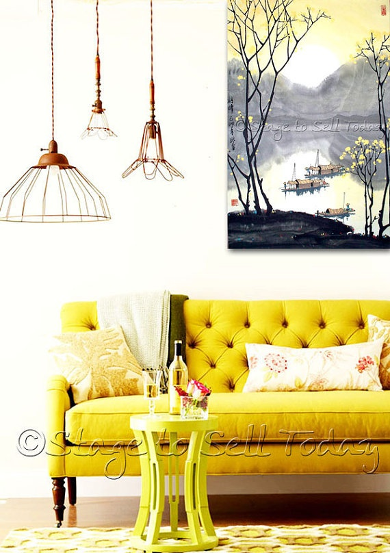 bold yellow tufted sofa
