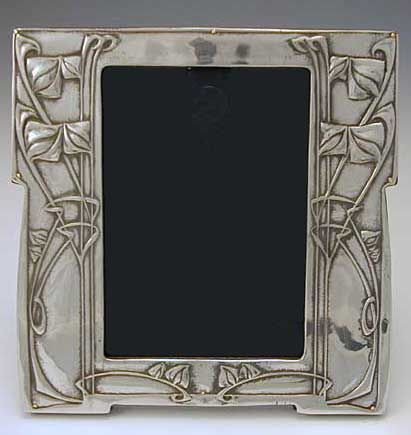 Archibald Knox (1864-1933) - For Liberty & Co. Picture Frame. Polished Pewter with Wood Back. England. Circa 1905. 18cm x 18cm.