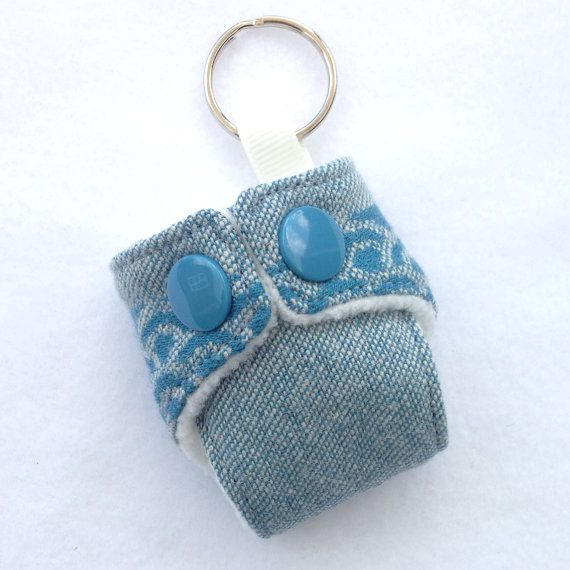 Item Details        (3)   Shipping & Policies Cute Mini Cloth Nappy Keyring made with Oscha Okinami Harris wrap scrap Great accessory for your changing bag Fleece lined and working snaps  If you have any questions, please feel free to send me a message!  You can also find me on Facebook https://www.facebook.com/pages/Girls-Got-Fabric