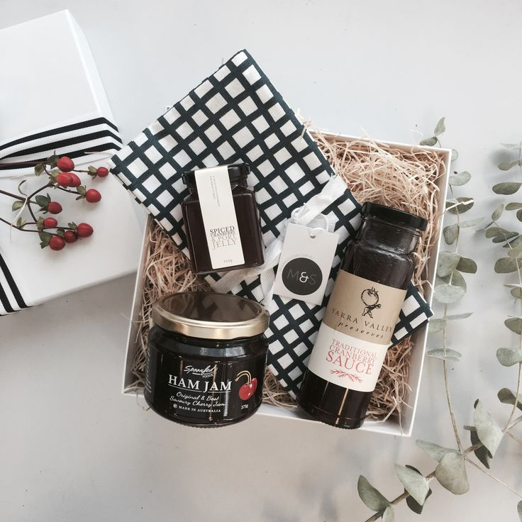 Christmas Gifts and Hamper Ideas. Christmas condiments paired beautifully with a designer tea towel.