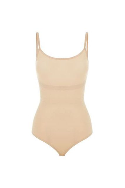 When you find a perfect-fit thong bodysuit, trust us: stock up. Get them in black and nude in every neckline — halter, turtle and long-sleeved scoop. Our favorite way to wear it? Find as close a match to your skin tone as possible for that nearly-nude effect under a plunging blazer or see-through dress.Related: How To Practice Safe Splurging #refinery29 http://www.refinery29.com/the-coveteur/87#slide-4