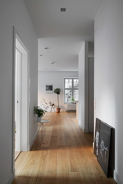 Fantastic Frank- bright interior with white walls and light wooden floors