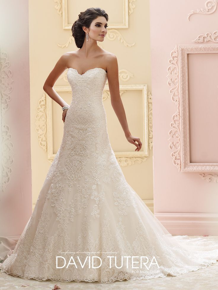 David Tutera for Mon Cheri | Style No. › 215265 | Strapless tulle and hand-beaded embroidered lace over satin A-line wedding dress, scalloped sweetheart neckline, back covered buttons, scalloped hemline, chapel length train, detachable spaghetti and halter straps included. Sizes: 0 – 20, 18W – 26W