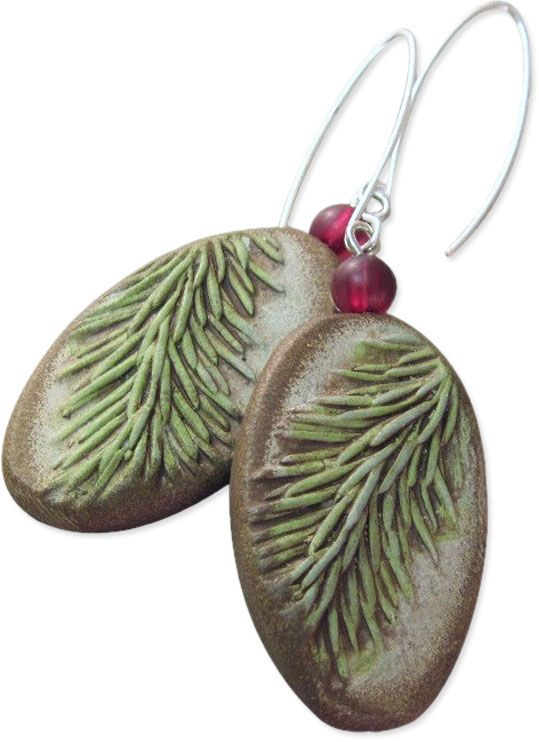 Understated polymer by Sandra DeYoung-Niese. She created her own mold from a real evergreen branch.  Beautiful!