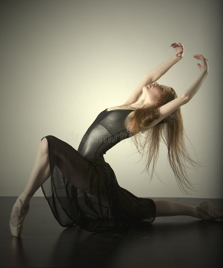 Pretty Young Flexible Female Dancer In Black Activewear