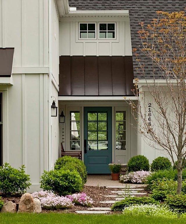 Lovely Exterior With A Blue Door For A Pop Of Color | Kastler Construction Design