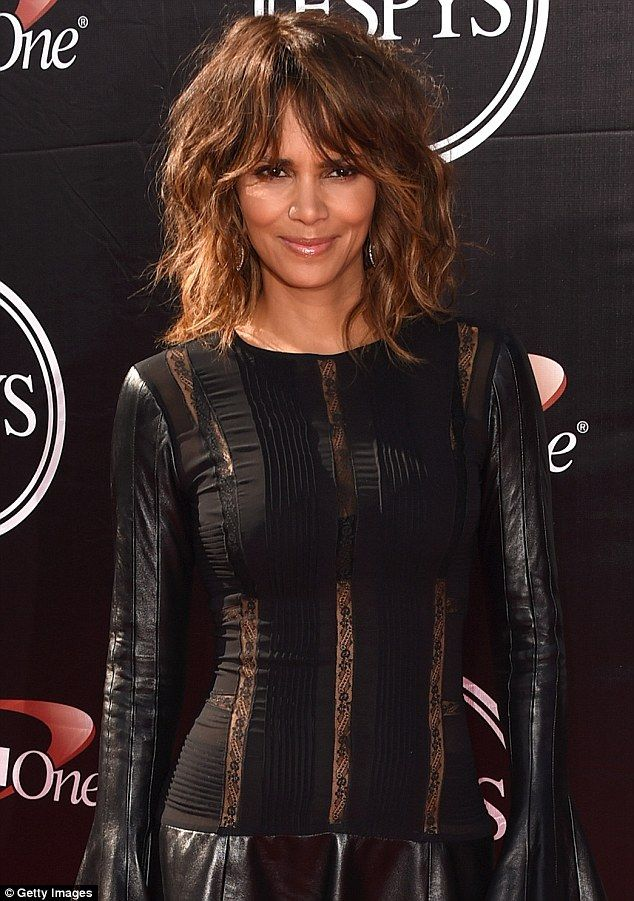 Tight in all the right places: Actress Halle Berry's leather-and-lace number highlighted her flawless figure