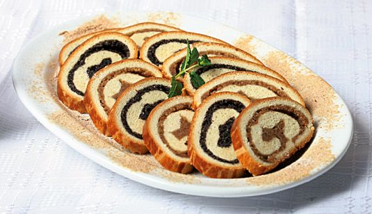 Bejgli - a tipical Hungarian Christmas pastry filled with poppy seed and walnut