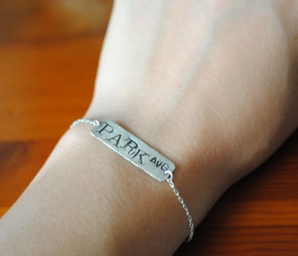 customized street sign bracelet.  we need these, @Corey Thompson and @Rachel Moore !!