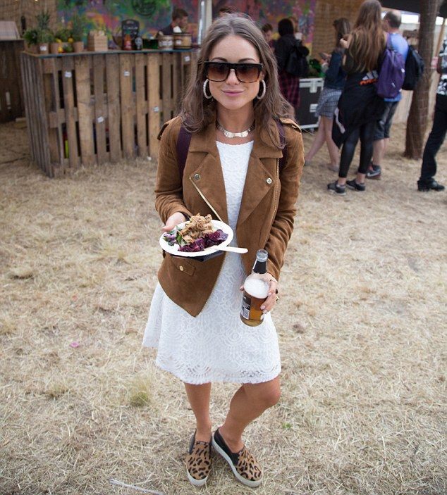 Festi-chic: The Made In Chelsea star, 26, cut a stylish figure in a skimpy white lace mini-dress that flaunted her toned pins, which she accessorised with a silver choker