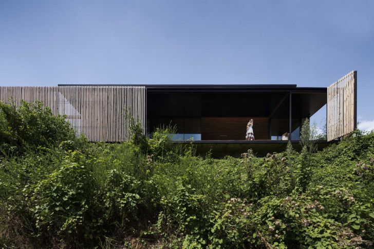 Industrial modern Sawmill House is built from recycled concret...