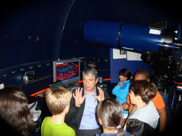 Students gather in the Woodlands Prep observatory to learn about space.