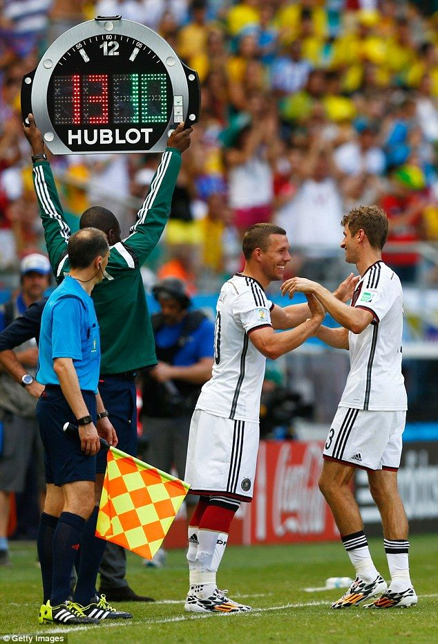 FIFA World Cup 2014 - Job well done: Lukas Podolski congratulates his match-winner as he leaves the field as a late substitute