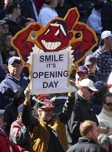 A Cleveland Indians fan holds up a sign celebrating opening day before their home opening MLB American League baseball game against the Toronto Blue Jays in Cleveland, Ohio April 5, 2012. - We're always hopeful on opening day!- cant wait for opening day this year