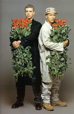 Neil Tennant and Chris Lowe of Pet Shop Boys with armfuls of red roses