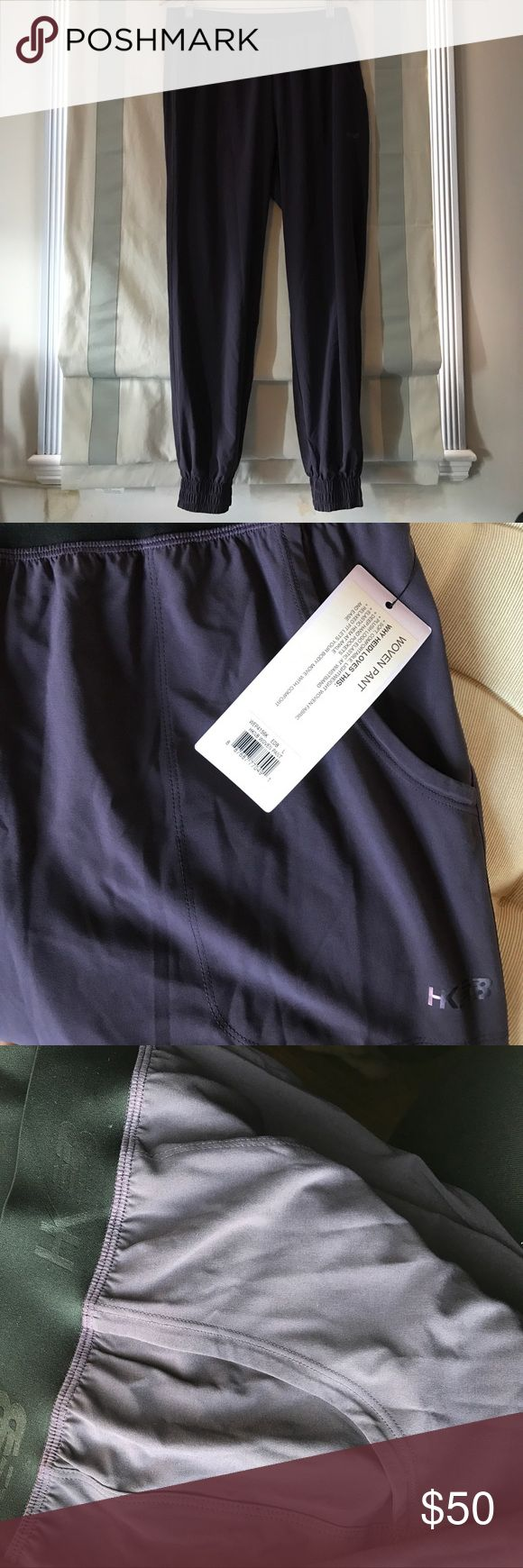 New Balance x Heidi Klum NWT Woven Pants size L. New Balance x Heidi Klum NWT Dark Purple Woven Yoga / City Track Pants. Side pockets and elastic hem, New Balance logo and waistband. NWT and never worn. Very comfortable, allowing movement yet very cute. Size L. New Balance Pants Track Pants & Joggers