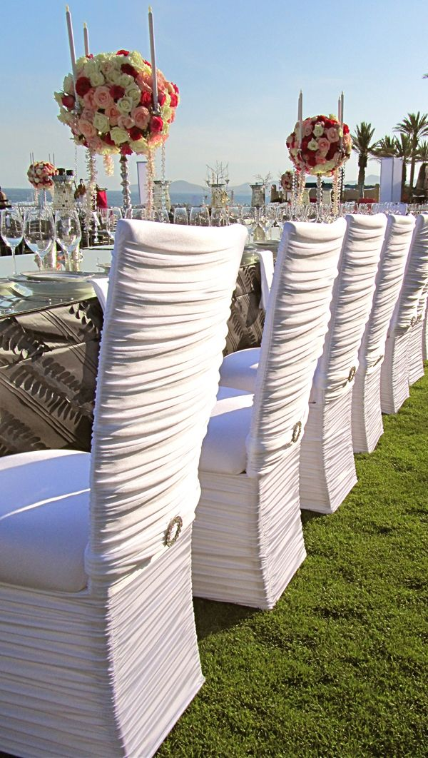 Pretty chair covers for an outdoor wedding
