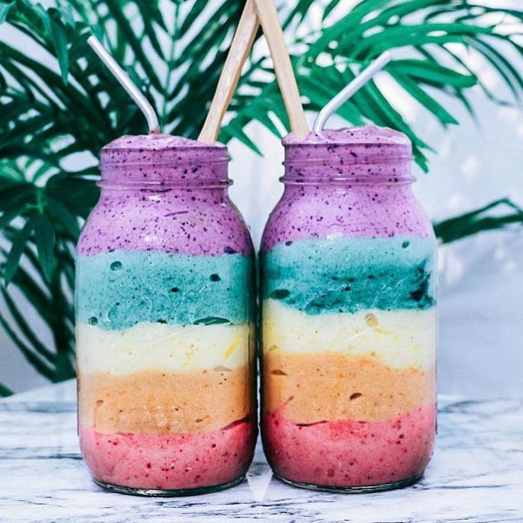 Rainbow smoothie treats   Red: 1 cup of frozen strawberries + 1 frozen banana. Orange: 1/2 cup of papaya chunks + 1 fro nana. Yellow: 1/4 cup of pineapple chunks + 1 fro nana. Green: 1 tsp. of spirulina powder + 1 fro nana. Purple: 1 cup of frozen blueberries + 1 fro nana. Blended and layered each one separately.