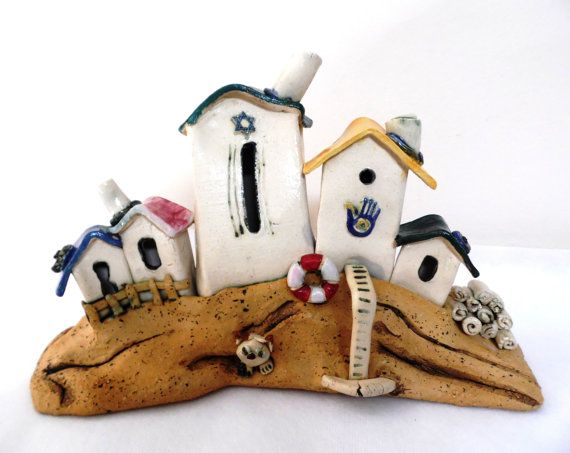 Ceramic statue of a rustic neighborhood made of yellow and white clay, synagogue with Star of David, Hamsa symbol for good luck. on Etsy, $72.01 CAD