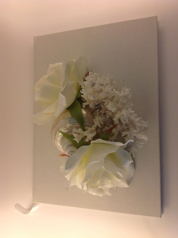 Handmade album with silk flowers and finger coral