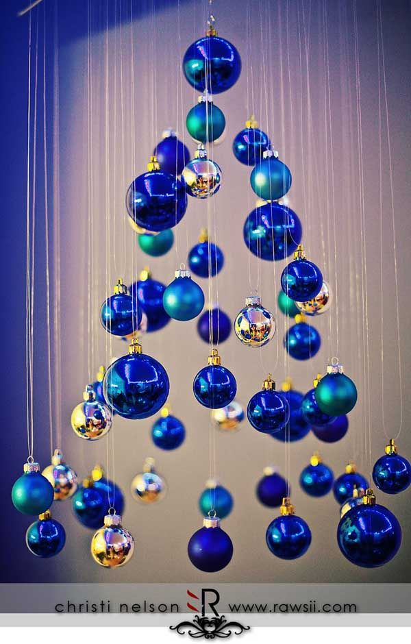 A Christmas tree made of bright blue Christmas ornaments