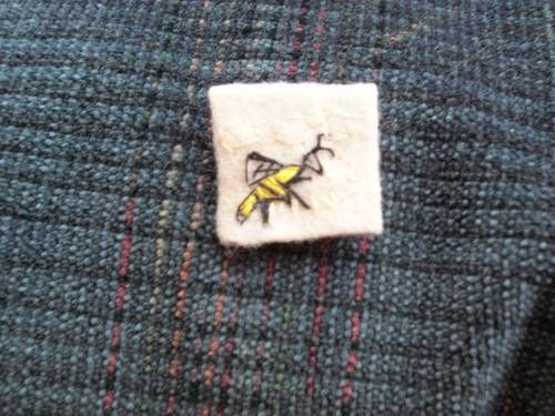 embroidery of a bee on 1x1inch felt