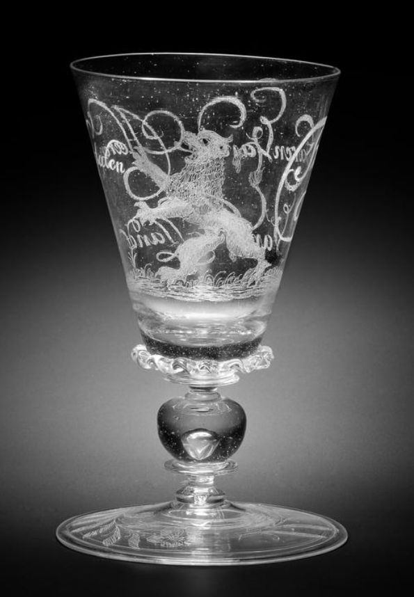 A Dutch diamond-point engraved façon de Venise goblet, possibly by Willem Mooleyser, circa 1683 The flared funnel bowl decorated with the Dutch Lion of the Province of Holland on a grassy sward, the reverse inscribed 'T Welvaren Van De Heeren Staten Van Hollandt, the base of the bowl applied with a vermicular collar, the stem with a ball knop enclosing a tear between two mereses, the conical foot with flower-sprays and the figure