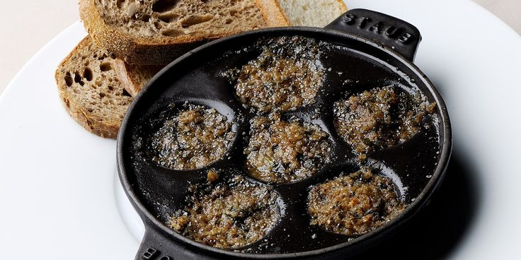 This snail cassolette makes a superb dinner party starter, packed with flavour from capers, anchovies, snails and parsley